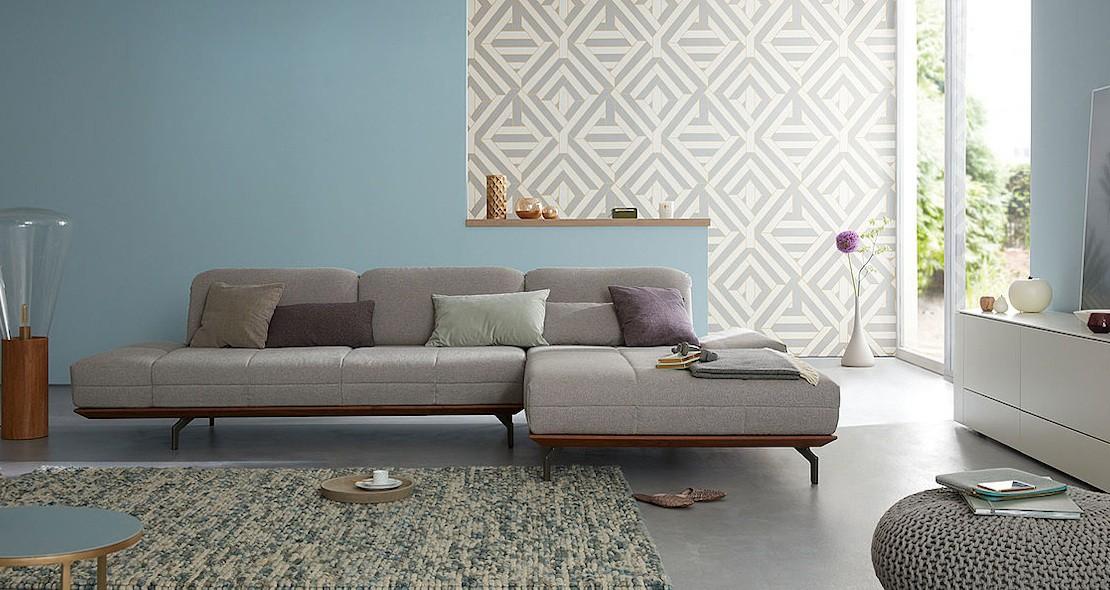 Canapé design avec méridienne dossier mobile recouvert de tissu